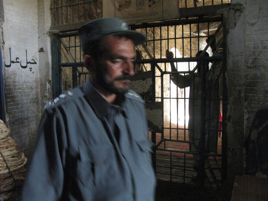 FILE- A prisoner leans against the entrance to the wing where political prisoners are kept at Sarposa prison in Kandhar city, in this 2009 file photo. Opposition threats to stall all parliamentary business seem to have helped break a log-jam in negotiations over access to sensitive Afghan detainee documents. THE CANADIAN PRESS/Dene Moore