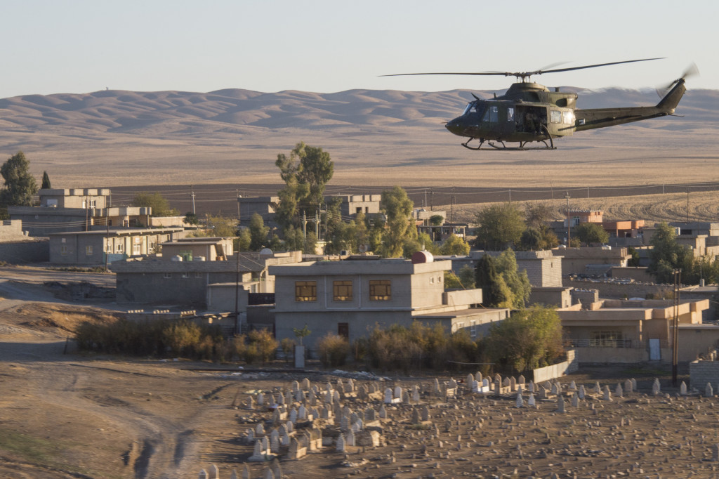 A CH-146 Griffon helicopter flies over an Iraqi village during Operation IMPACT in Northern Iraq on November 23, 2016. Photo: Operation IMPACT, Canadian Forces Combat Camera IS03-2016-0043-003 ~ Un hélicoptère CH-146 Griffon survole un village irakien au cours de l'opération IMPACT dans le nord de l'Irak, le 23 novembre 2016. Photo : Opération IMPACT, Caméra de combat des Forces canadiennes IS03-2016-0043-003