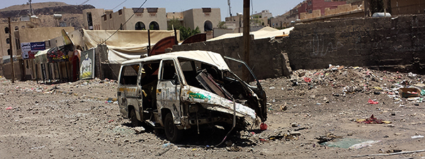 Sana'a_after_airstrike_20-4-2015_-_Widespread_destruction-_15_banner_dark
