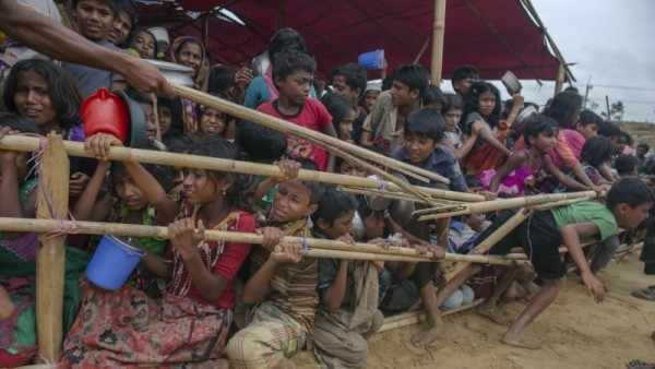 Rohingya Muslim children, who crossed over from Myanmar into Bangladesh, struggles to keep in queue due to pushing as they wait for their turn to collect meals distributed to children and women by Turkish aid agency at Thaingkhali refugee camp, Bangladesh, Friday, Oct. 20, 2017. (AP Photo/Dar Yasin)